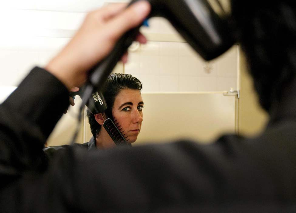 """I can't just grow my sideburns and have them there all the time,"" said Gudz after spending at least an hour in the girls' washroom smoothing her hair back to a strickingly accurate Elvis-style do. (HADAS PARUSH / WINNIPEG FREE PRESS)"