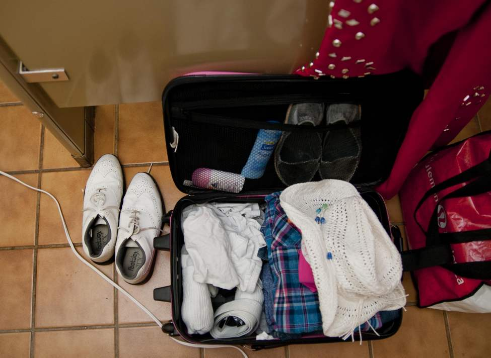 Elvis shoes and suits, and a regular change of clothes are neatly packed while Marnie Lee Gudz gets herself ready to become Miss Elvis Lee in the ladies' room of the Gimli Rec Centre. (HADAS PARUSH / WINNIPEG FREE PRESS)