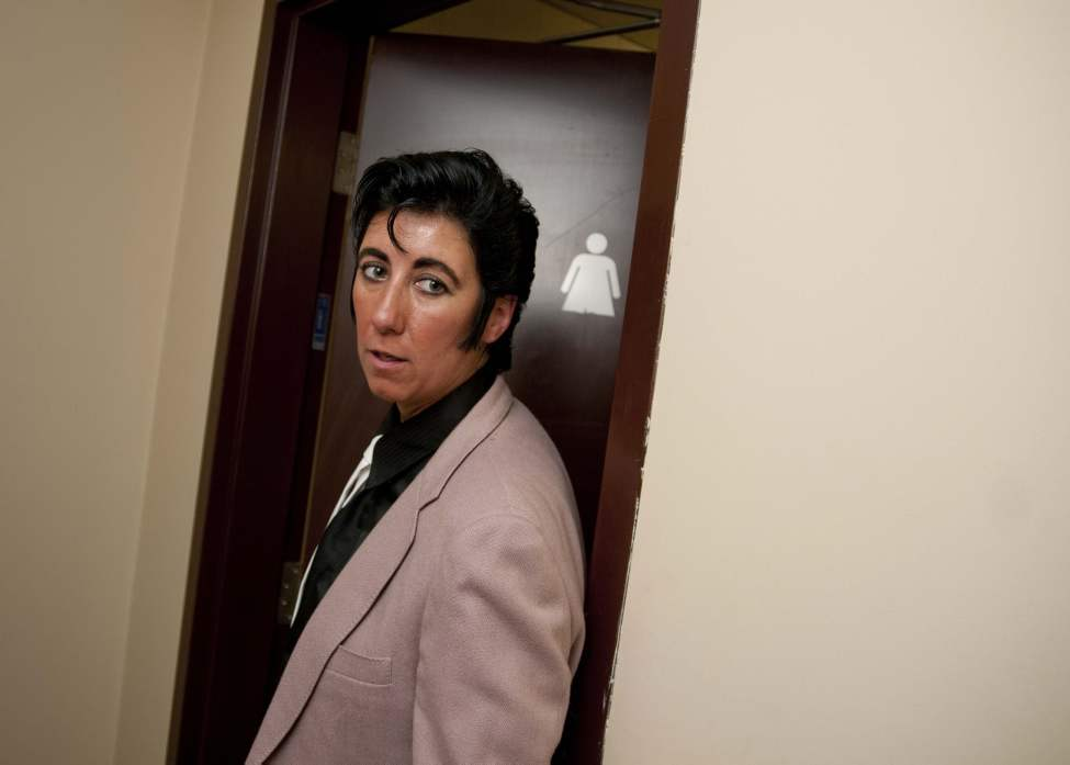 Fully transformed, Miss Elvis Lee walks out of the ladies' room. (HADAS PARUSH / WINNIPEG FREE PRESS)