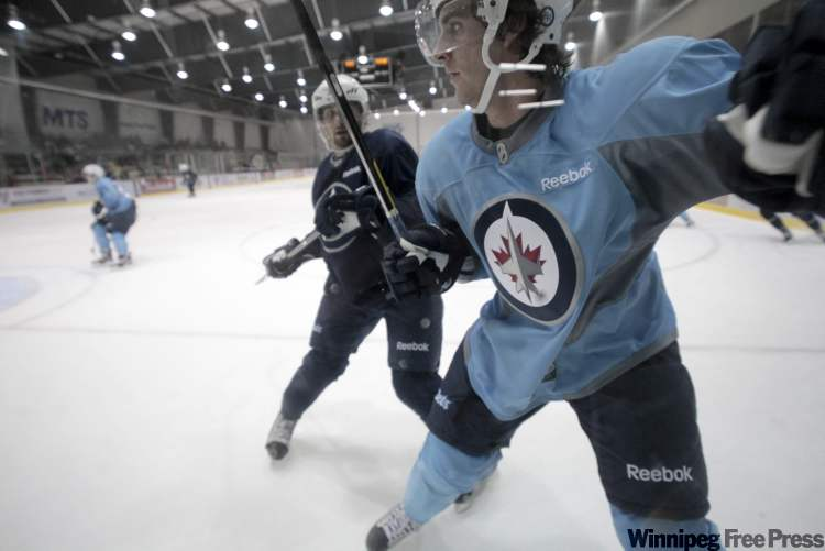 Jets prospect Julian Melchiori's (right) size and grit have made a favourable impression during training camp.