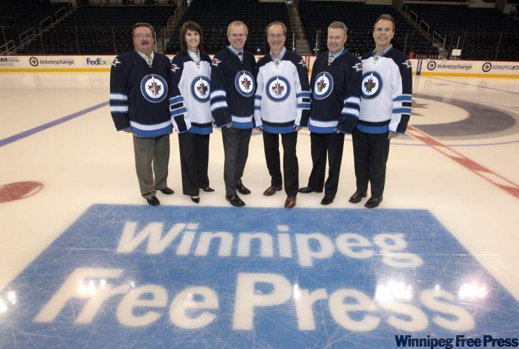 Officials of the Winnipeg Free Press and Winnipeg Jets met at centre ice Thursday at the MTS Centre to announce a continuing long-standing partnership agreement.   Taking part (from left) were:  Free Press vice-president sales, Laurie Finley; True North senior vice-president sales, Norva Riddell; Free Press Publisher, Bob Cox; True North President & CEO, Jim Ludlow; Free Press vice-president marketing, Bruce Leslie; and Winnipeg Jets GM Kevin Cheveldayoff.