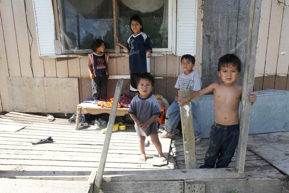 Wasagamack First Nation- Richard Andrews' grandchildren run in and outside their rundown trailer. Up to 13 people are crammed into the home without running water.    