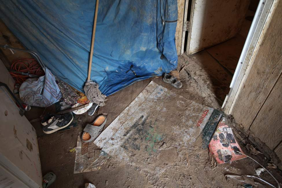 Filthy floors and rotting walls are a grim reality for the 13 people who call Richard Andrews' rundown trailer home. (JOE BRYKSA / WINNIPEG FREE PRESS)