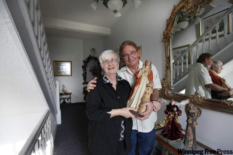 Jean and Linda Aquin hold a statue of St. Martha, for whom the convent was named. The story behind how they came to own the statue is strange and wonderful in itself.
