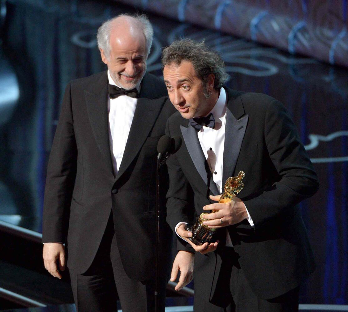 Toni Servillo, left, and Paolo Sorrentino accept the Academy Award for best foreign language film of the year for The Great Beauty.