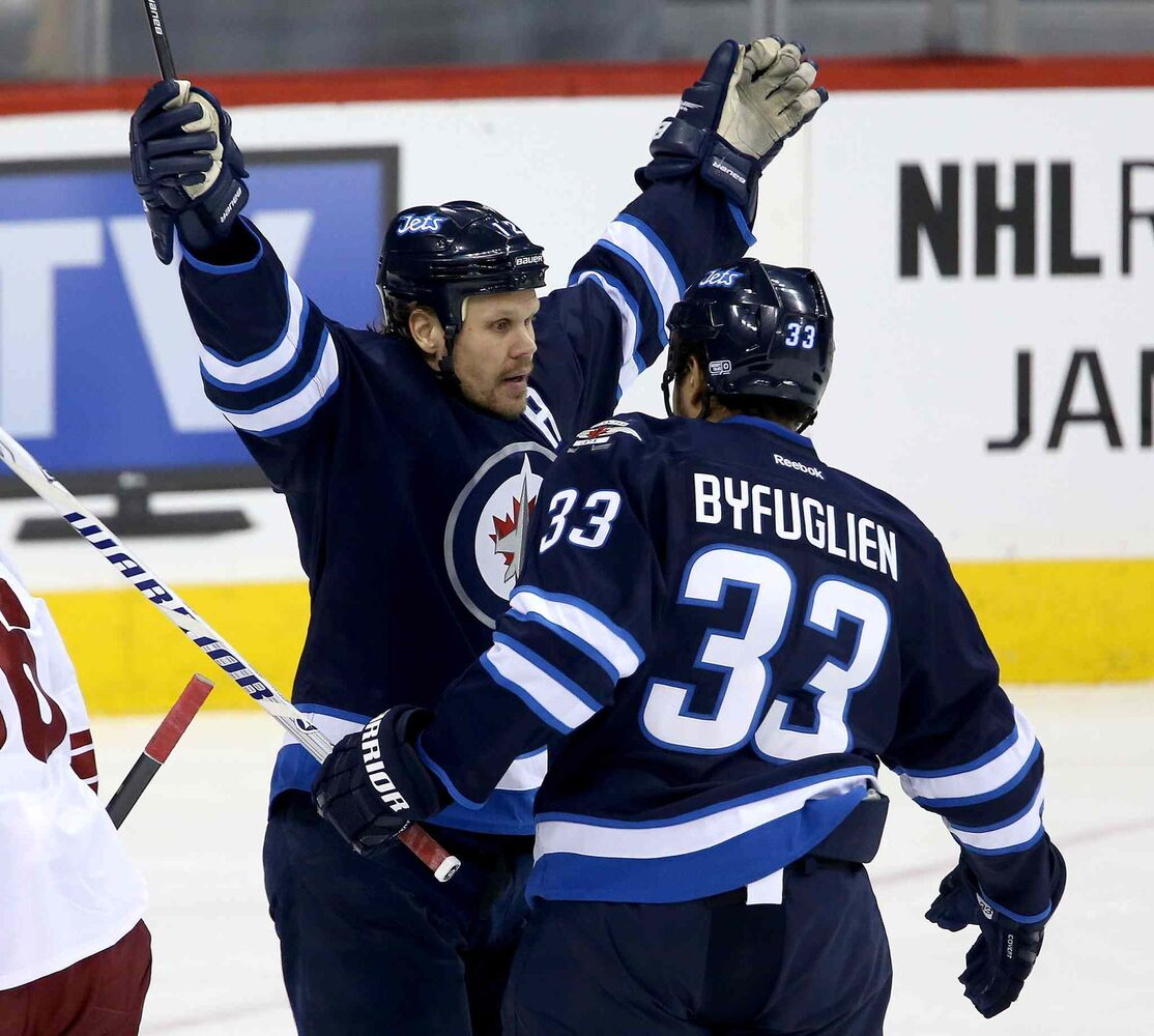 Olli Jokinen celebrates with Dustin Byfuglien after scoring in the first period.