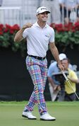 Billy Horschel reacts after sinking a short putt on the 18th green to win the Tour Championship golf tournament Sunday, Sept. 14, 2014, in Atlanta. Horschel finished at 11 under par, three shots ahead of Jim Furyk, and Rory McIlroy. (AP Photo/John Amis)