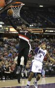 Portland Trail Blazers guard Wesley Matthews, left, goes for the layup past Sacramento Kings guard Ray McCallum during the first half of an NBA basketball game in Sacramento, Calif., Sunday, March 1, 2015. (AP Photo/Rich Pedroncelli)