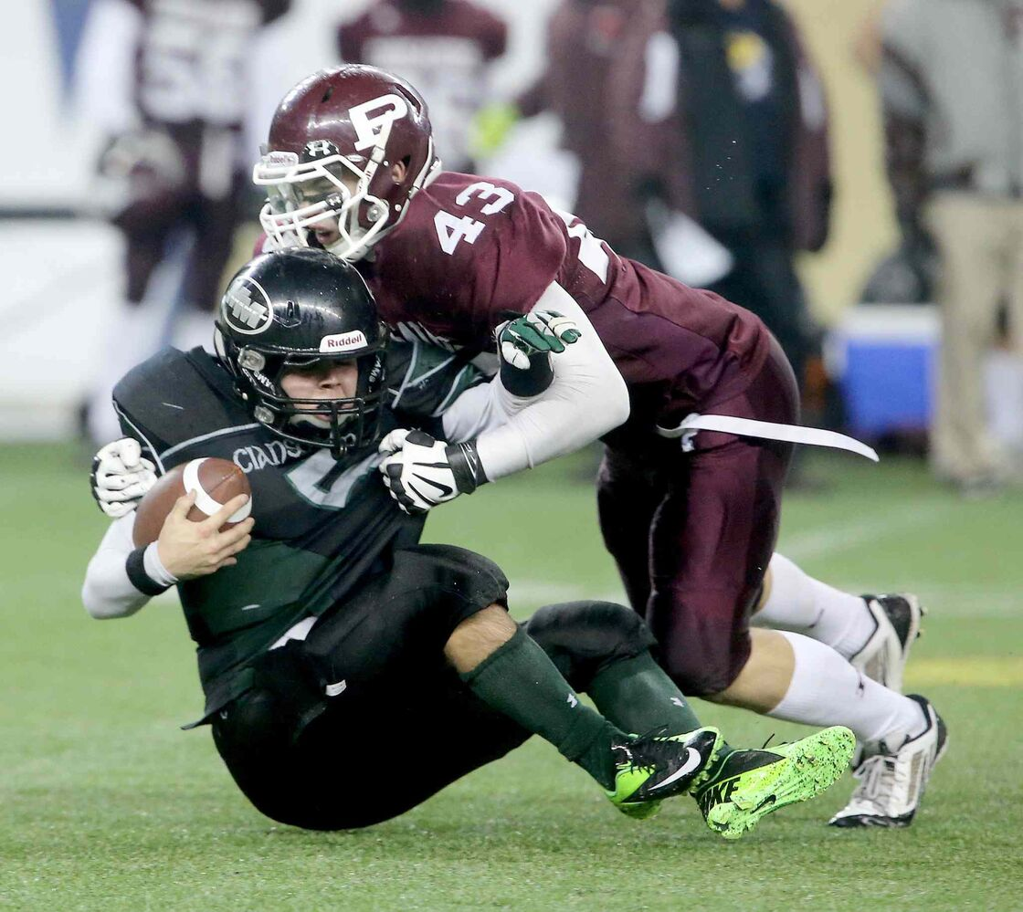 Samson Abbott of the St. Paul's Crusaders sacks Murdoch McKay Clansmen quarterback Drenin Busch during the second half. (Trevor Hagan / Winnipeg Free Press)