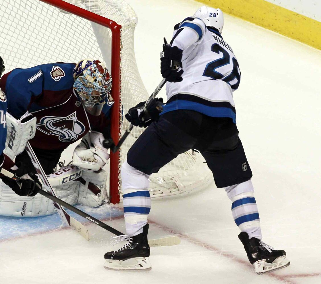 Colorado Avalanche goalie Semyon Varlamov stops a Blake Wheeler shot in the third period. (David Zalubowski / The Associated Press)