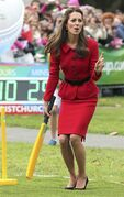 FILE - This is a Monday, April 14, 2014 file photo of Britain's Kate, the Duchess of Cambridge, as sheplays cricket in Latimer Square in Christchurch, New Zealand, Monday, April 14, 2014. Kate�s dilemma: What to pack for a two-week trip, when your itinerary includes everything from state receptions and church services to toddler playdates and cricket games? For the Duchess of Cambridge, who�s rounding up her trip to Australia and New Zealand with husband Prince William and 8-month-old son George, there were additional sartorial dilemmas: Do royals take off their shoes at the beach? And what�s the most ladylike way to climb into a fighter jet while in a pencil dress and high heels? (AP Photo/Martin Hunter, Pool, FILE)
