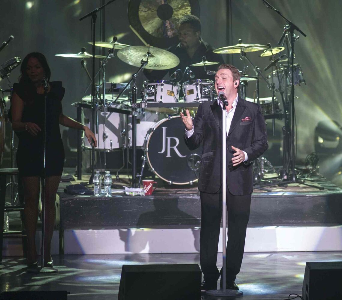 Johnny Reid makes jolly during his concert at the Centennial Concert Hall Monday night.