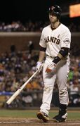 San Francisco Giants catcher Buster Posey (28) reacts after striking out against Washington Nationals pitcher Stephen Strasburg during the sixth inning of a baseball game in San Francisco, Tuesday, May 21, 2013. (AP Photo/Jeff Chiu)