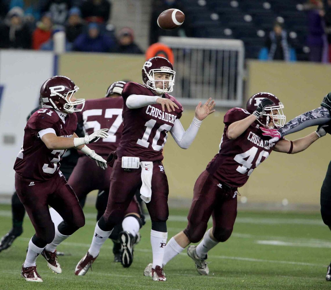 St. Paul's Crusaders AAA football team quarterback Drake Lesperance (10) fires a pass during the second half of the team's Anavets Bowl victory. (Trevor Hagan / Winnipeg Free Press)