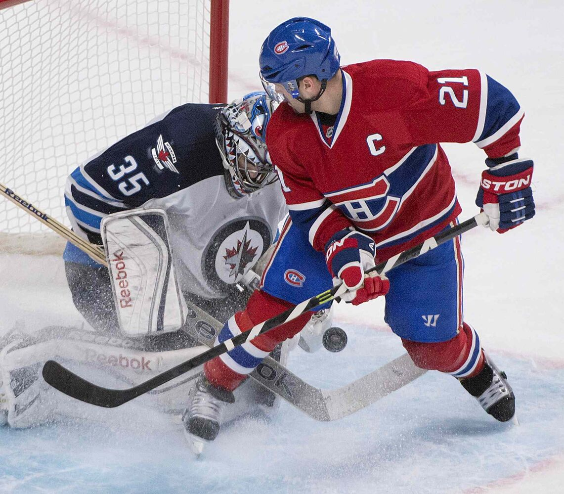 Montreal Canadiens' Brian Gionta struggles with the puck in front of Winnipeg Jets goalie Al Montoya Sunday in Montreal.