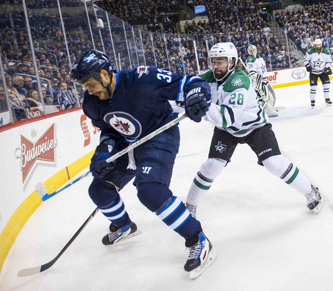 Winnipeg Jets' Dustin Byfuglien (#33) collides with Dallas Stars' David Schlemko (#28) during second period Saturday.  (David Lipnowski / Winnipeg Free Press)