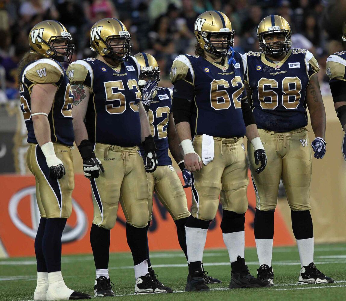 About all the Winnipeg Blue Bombers' offensive linemen could do was stare down the Edmonton Eskimos late in the game Thursday. (Phil Hossack / Winnipeg Free Press)