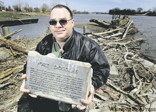 PHIL HOSSACK / WINNIPEG FREE PRESS Ernest Cucheron shows the Fort Douglas plaque, which was swept off its cairn by ice near the Alexander Docks during the flooding.