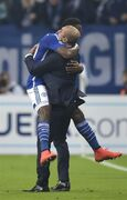 Schalke's Chinedu Obasi, left, hugs head coach Roberto Di Matteo after scoring his side's first goal during the Champions League group G soccer match between Schalke 04 and Sporting in Gelsenkirchen, Germany, Tuesday, Oct. 21, 2014.(AP Photo/Martin Meissner)