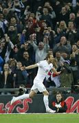 England's Harry Kane celebrates after scoring his side's 4rth goal during the Euro 2016 Group E qualifying soccer match between England and Lithuania at Wembley Stadium in London, Friday, March 27, 2015. (AP Photo/Kirsty Wigglesworth)
