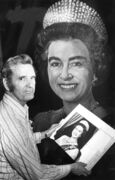 Artist Gil Burch with his finished portrait of Queen Elizabeth. The painting would go on to hang from the rafters for 20 years in the Winnipeg Arena.