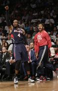 Atlanta Hawks' Paul Millsap (4) reacts with teammate after making a three point basket during the second half of Game 6 against the Brooklyn Nets in a first round NBA playoff basketball game Friday, May 1, 2015, in New York. The Hawks won the game 111-87. (AP Photo/Frank Franklin II)