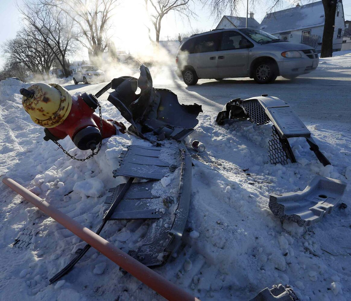 The cold also caused collateral damage, leaving car parts  and infrastructure damage at various intersections around the city including this fire hydrant on Arlington St. at Burrows Avenue on Jan. 2.