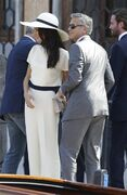 George Clooney and Amal Alamuddin leave the Cipriani hotel in Venice, Italy, Monday, Sept. 29, 2014. Clooney and Amal married Saturday, Sept. 27, the actor's representative said, out of sight of pursuing paparazzi and adoring crowds. (AP Photo/Andrew Medichini)