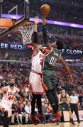 Milwaukee Bucks guard O.J. Mayo (00) shoots over Chicago Bulls forward Taj Gibson during the first half in Game 5 of the NBA basketball playoffs Monday, April 27, 2015, in Chicago. (AP Photo/Charles Rex Arbogast)