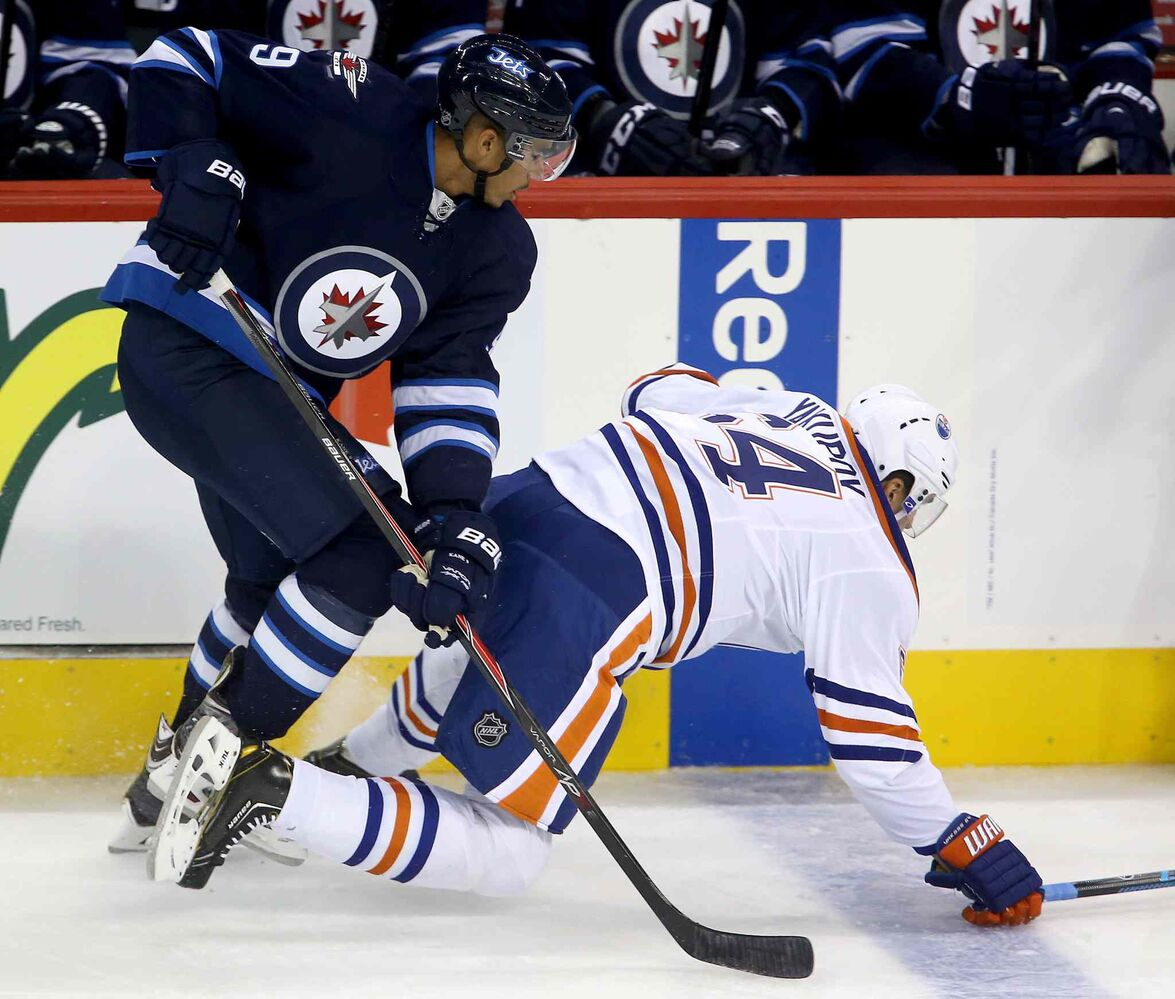 Winnipeg Jets forward Evander Kane takes down Edmonton Oiler Nail Yakupov in the first period. (TREVOR HAGAN / THE CANADIAN PRESS)