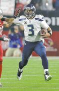 Seahawks quarterback Russell Wilson says some of his runs 'just happen.'