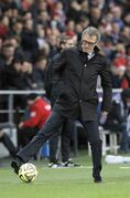 Paris Saint Germain's head coach Laurent Blanc controls the ball during their League One soccer match between Paris Saint Germain and Montpellier, at Parc des Princes stadium, in Paris, Saturday, Dec. 20, 2014. (AP Photo/Francois Mori)