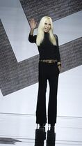 Fashion designer Donatella Versace waves on the runway after presenting her women's spring-summer 2015 fashion collection, part of the Milan Fashion Week, unveiled in Milan, Italy, Friday, Sept. 19, 2014. (AP Photo/Luca Bruno)