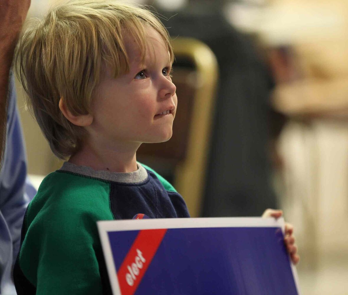 Four year old Cole Chebbert holds a sign for Jim Bell. Conservative Candidate for Kildonan-St. Paul at his riding headquarters Monday evening.   (Ruth Bonneville / Winnipeg Free Press)