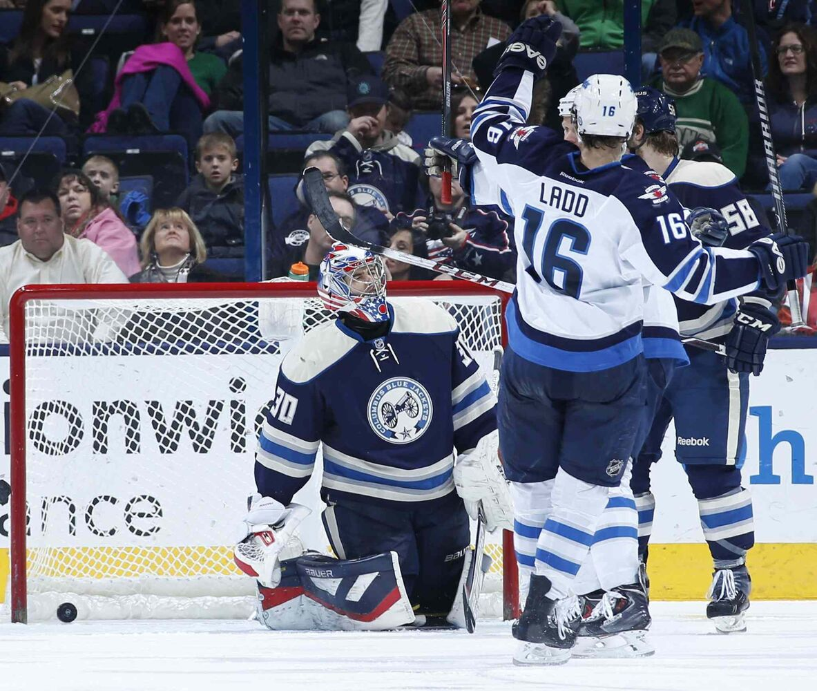 Andrew Ladd celebrates the Jets' third goal Monday against Columbus. (Sam Green / Tribune Media MCT)