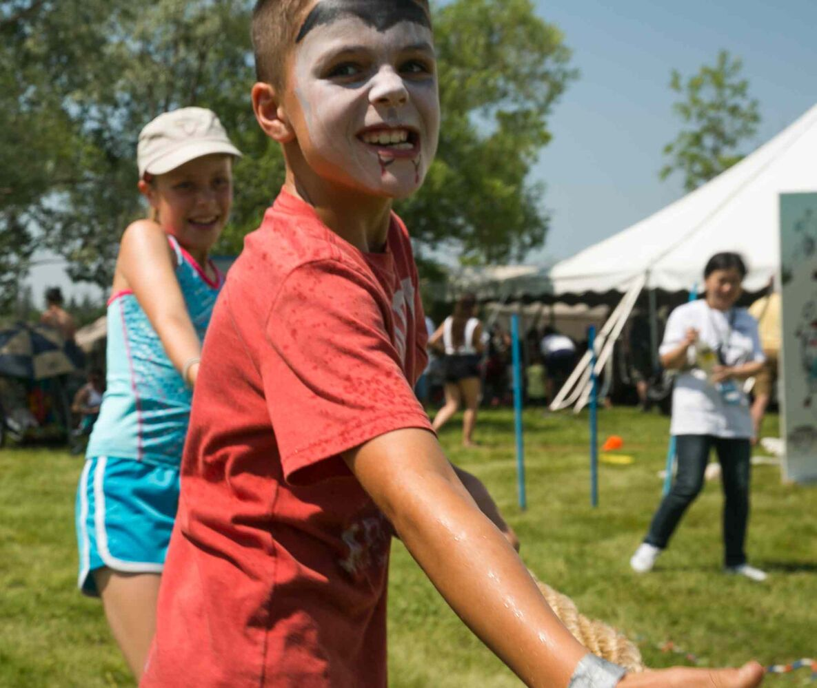 Henry Johnson, 8, plays tug-of-war at the Winnipeg Folk Festival Friday afternoon. Winnipeg Folk Fest 2015 kids - see Jen Zoratti column July 10, 2015 - MELISSA TAIT / WINNIPEG FREE PRESS (WINNIPEG FREE PRESS)