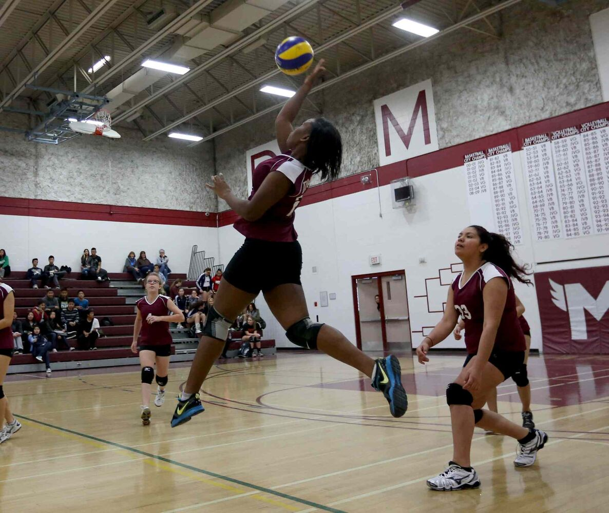 DCMI Maroons player Jada Gibbs hits the ball during the third set. (TREVOR HAGAN / WINNIPEG FREE PRESS)
