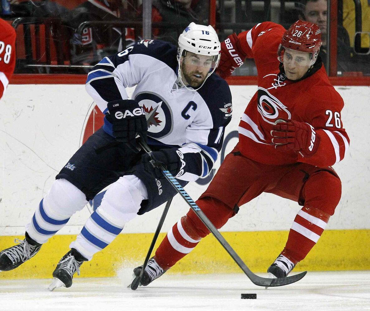 Winnipeg Jets' Andrew Ladd (16) works against Carolina Hurricanes' John-Michael Liles (26) during the first period at the PNC Arena in Raleigh, N.C. on Tuesday. (Chris Seward / Raleigh News & Observer/ Tribune Media MCT)