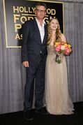 President of the Hollywood Foreign Press Association Theo Kingma, left, and Greer Grammer attend the press conference where she was named Miss Golden Globe 2015 on Thursday, Nov 20, 2014, in West Hollywood, Calif (Photo by Richard Shotwell/Invision/AP)
