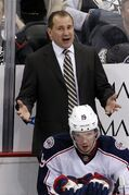 FILE - In this April 26, 2014, file photo, Columbus Blue Jackets head coach Todd Richards talks with an official during a first-round NHL playoff hockey game against the Pittsburgh Penguins in Pittsburgh. With contract talks with restricted free agent center and leading scorer Ryan Johansen at an impasse, Richards says they are proceeding as if Johansen will not be available for the upcoming season. (AP Photo/Gene J. Puskar, Filr)