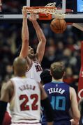Chicago Bulls' Paul Gasol dunks during the first half of an NBA basketball game against the Charlotte Hornets in Chicago, Sunday, Oct. 19, 2014. (AP Photo/Paul Beaty)