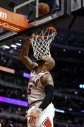 Chicago Bulls power forward Carlos Boozer (5) scores a basket against the San Antonio Spurs during the second half of an NBA basketball game on Tuesday, March 11, 2014, in Chicago. The San Antonio Spurs defeated The Chicago Bulls 104-96. (AP Photo/Andrew A. Nelles)