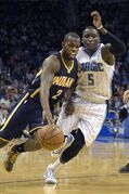 Indiana Pacers guard Rodney Stuckey (2) drives past Orlando Magic guard Victor Oladipo (5) during the first half of an NBA basketball game in Orlando, Fla., Sunday, Jan. 25, 2015. (AP Photo/Phelan M. Ebenhack)