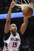 Atlanta Hawks center Al Horford (15), of Dominican Republic, dunks against the Brooklyn Nets during the first half of an NBA basketball game, Wednesday Jan. 28, 2015, in Atlanta. (AP Photo/John Amis)