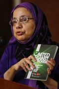 Shahina Siddiqui, President of the Islamic Social Services Association, holds the handbook