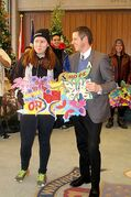 Ocean White, a Grade 12 student at Children of the Earth High School, presents Mayor Brian Bowman with paper butterfly artwork.