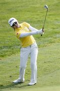 Ayako Uehara, of Japan, chips onto the green on the ninth hole during the final round of the Marathon Classic LPGA golf tournament at Highland Meadows Golf Club in Sylvania, Ohio, Sunday, July 20, 2014. (AP Photo/Rick Osentoski)