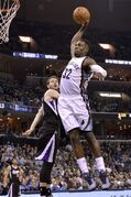 Memphis Grizzlies forward Jeff Green (32) dunks past Sacramento Kings guard Nik Stauskas in the second half of an NBA basketball game Monday, March 30, 2015, in Memphis, Tenn. (AP Photo/Brandon Dill)