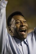 FILE - In this Nov. 19, 2008 file photo, Brazil's soccer great Pele greets supporters prior to a friendly soccer match, in Brasilia, Brazil. A Brazilian hospital says Pele has been transferred to a