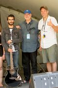 (From left): Adam Hanney, Galaxie's Greg Torrington and Chris Frayer, artistic director of the Winnipeg Folk Festival, pose after Hanney was named Galaxie Rising Star at the conclusion of this year's Young Performers Program at the Folk Festival on July 11.